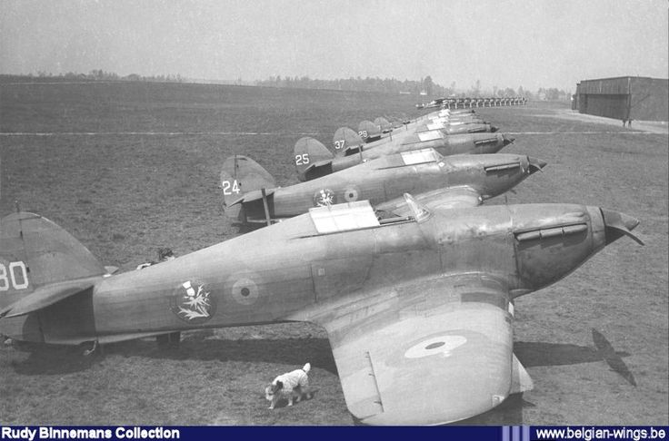 "Hawker Hurricane H-30 heading a line up of 2/I/2Aé (Chardon/Thistle) fighters at Schaffen-Diest during the ""Drôle de Guerre"" (Phoney War) in 1939. The aircraft in the background are the Gloster Gladiators I of 1/I/1Aé (Comet) also based at Schaffen."
