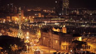 Stock Footage |panoramic view of the city of barcelona at night, looking down from mont juic | License and download using the VidLib iOS app with over 100.000 Royalty Free Clips