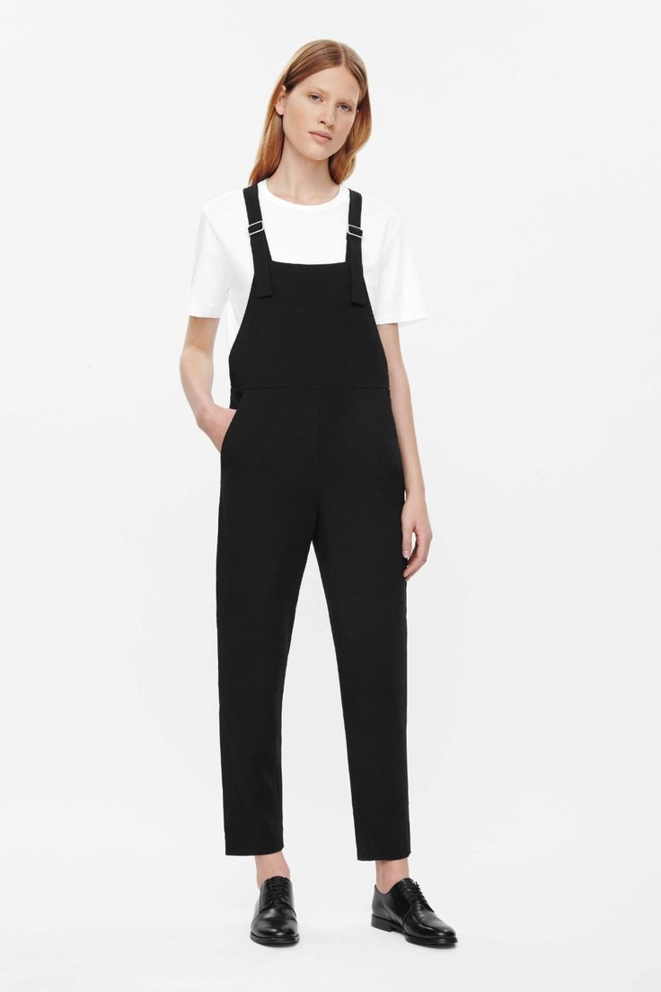 Made from melange fabric with matching adjustable straps that extend over the front, these dungarees are a simple, minimal design. Tapering towards the ankle, they have a slim back, slanted front pockets and a concealed zip fastening in the side seam.