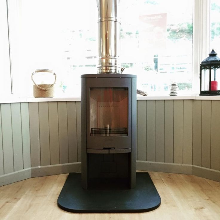 The Contura 810 is a great wood burner for The Atlantic Cafe, Portreath, as it is quite a modern, sturdy fire that produces a wonderful flame picture.     #contura #810 #fire #stove #wood #burner #freestanding #cafe #portreath #atlantic #flame #heat #log #store #modern #contemporary #kernowfires #wadebridge #redruth #cornwall