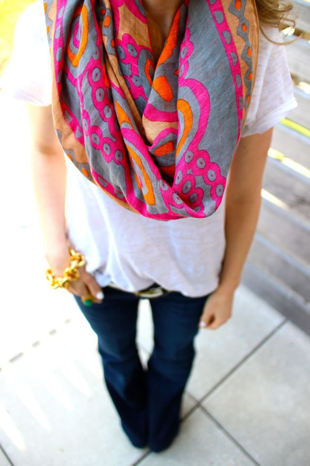 The classic jeans and a white tee get taken up a notch with the addition of a bold scarf