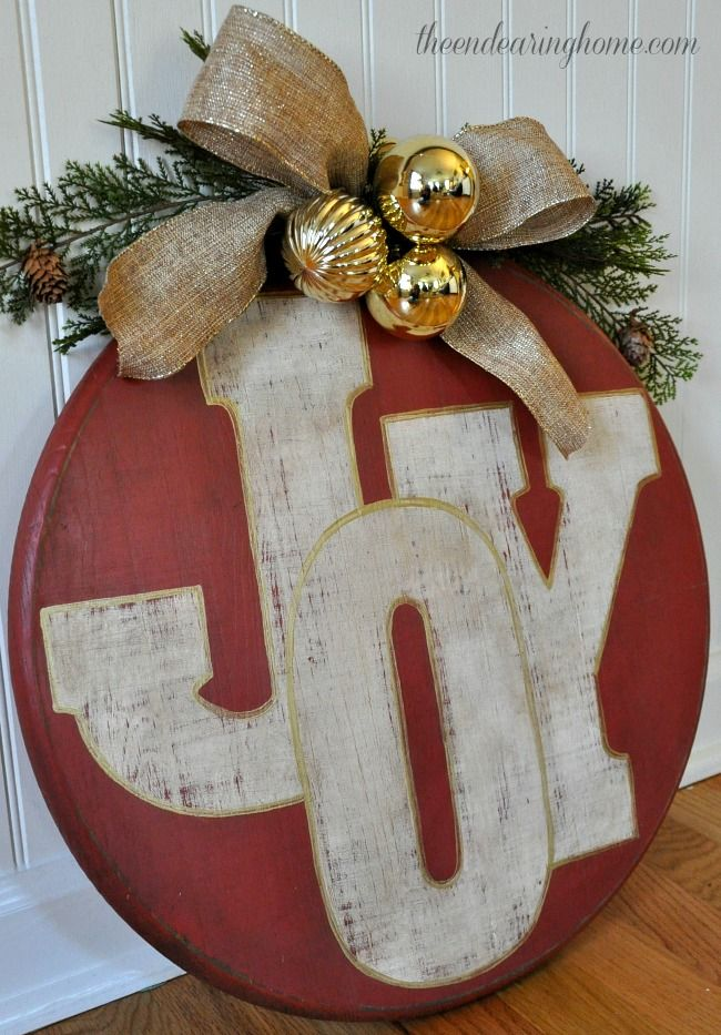 I'm not so big on the rustic thing, but in general this concept could be a really great, durable alternative to a wreath.