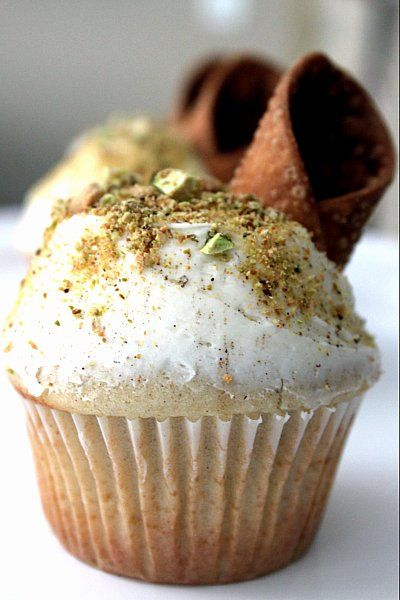 Cannoli Cupcakes  tip:  cook ricotta with 1/4 c cornstarch to thicken.  Use mini choc chips instead of pistachios