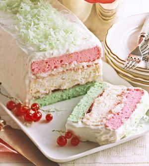 Neapolitan Christmas Cake. With its pink, green, and white layers, this stacks up to one festive cake for the holidays. Fill and frost the layers with a heavenly whipped cream frosting and add a sprinkle of coconut.