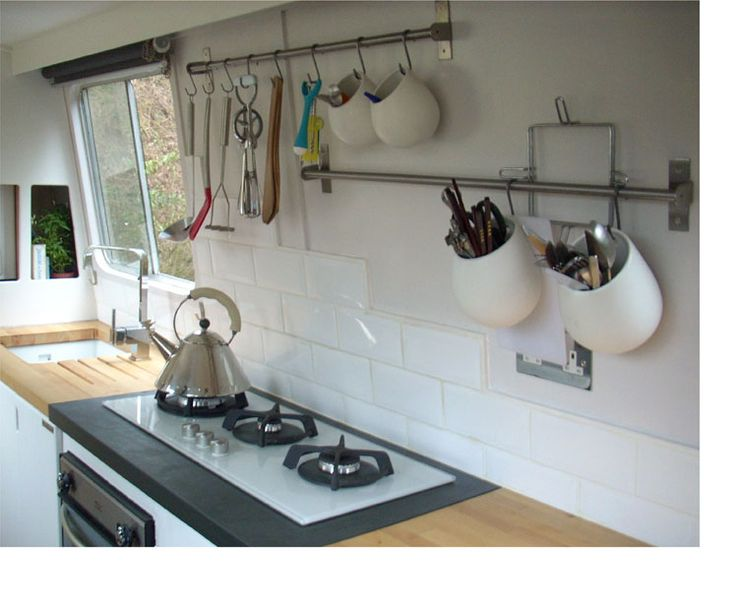 Like the utensil containers hanging from Hand Rails- Small House Interior Design