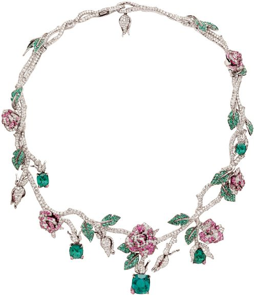 Dior Precieuses Rose Necklace one-of-a-kind rose necklace dripping with over 32 carats of diamonds, 11.5-carats of rubies and almost 377 emeralds, the largest weighing in at 7.81-carats. Via AM.