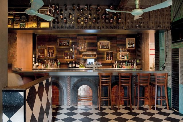 By Techne Architects: Bridge Hotel Melbourne-The bar front is made of old fireplaces.