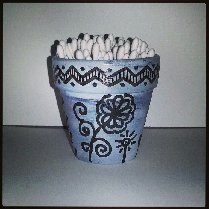Zentangle and doodles decoration on terracotta pot