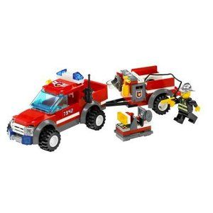Lego City Off Road Fire Rescue (7942).  This truck unit comes with several pieces of equipment that should keep a fire-fighting kid happy. It includes a hose, a removable saw and a trailer that can be detached. It reminds me more of a firefighting unit you might see in a rural area, rather than a city. Overall, it's a great little set.