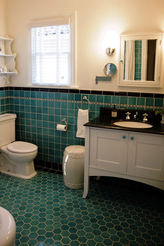 Another retro style bathroom in black, white, and turquoise tile on walls and floor.