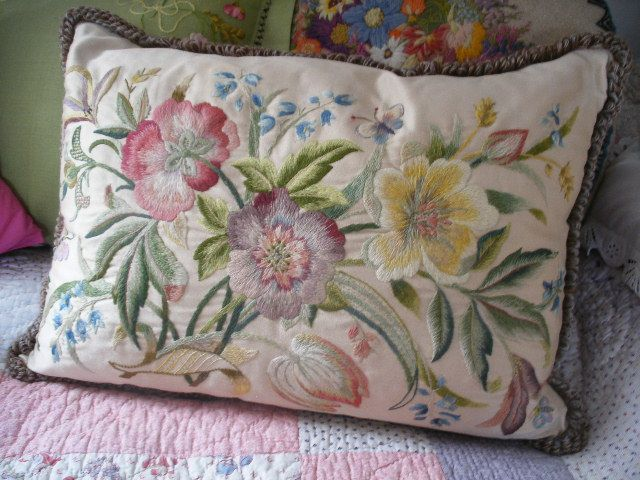 crewel embroidered cushion