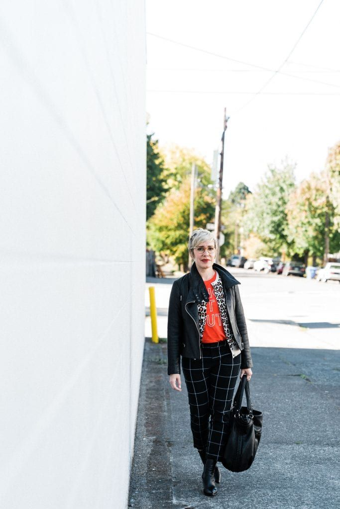 I love the bold pattern mixing and the London-inspired grid print pants.  The pop of red just plays so well with the leopard d313187c7909e