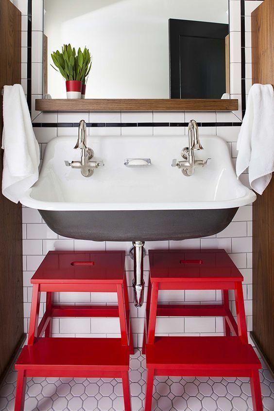 Kohler brockway sink in bathroom with red stools
