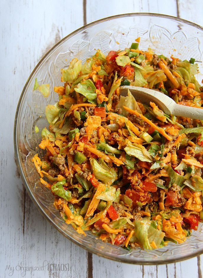 Taco Salad - I'll use lean beef, Baked Doritoes, low-fat cheese and fat-free French to make this healthier :)