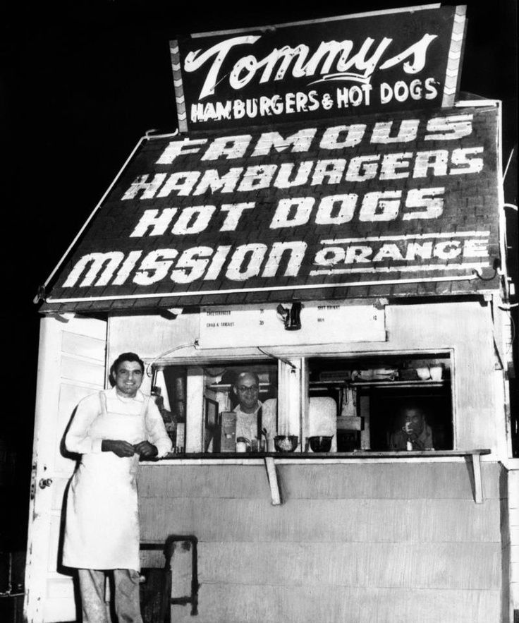 Founder Tommy Koulax standing in front of his original hamburger stand at the corner of Beverly and Rampart in Los Angeles (ca. 1946)