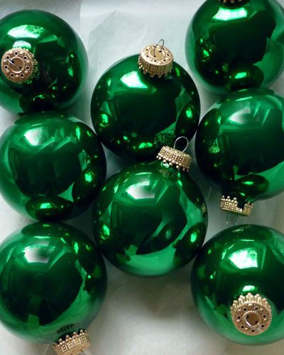 Pull ribbon through the tops of Emerald Ornaments to make garland decorations