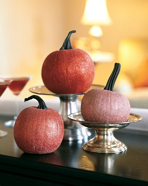 simple glittered pumpkins.  To make one, use a medium-size paintbrush to spread a layer of white glue over the surface of a small pumpkin. Hold pumpkin over a paper plate or a sheet of newspaper to catch excess glitter. Sprinkle powder glitter over pumpkin in several colors