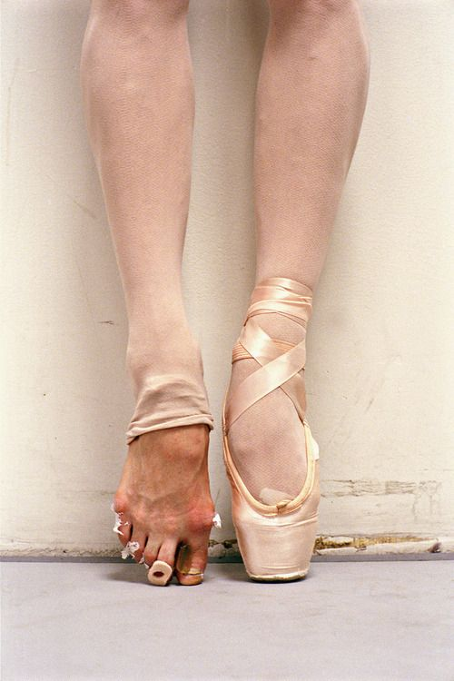 """""""If I had to title the picture, I would call it Reality and Dreams,"""" says Leutwyler. """"The foot en pointe is what every little girl dreams of. The other is the hard, hard work, and the reality.""""  Behind the Curtain at the New York City Ballet"""
