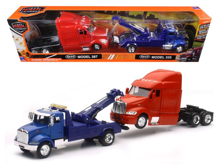 Peterbilt Model 335 Tow Truck Blue and Peterbilt Model 387 Cab Red 1/43 by New Ray - Wheels roll. Detailed interior, exterior. Cabin is diecast metal, the rest are plastic parts. Dimensions approximately L-16.5, W-2.5, H-4 inches. Please note that manufacturer may change packing box at any time. Product will stay exactly the same.-Weight: 2. Height: 6. Width: 11. Box Weight: 2. Box Width: 11. Box Height: 6. Box Depth: 6