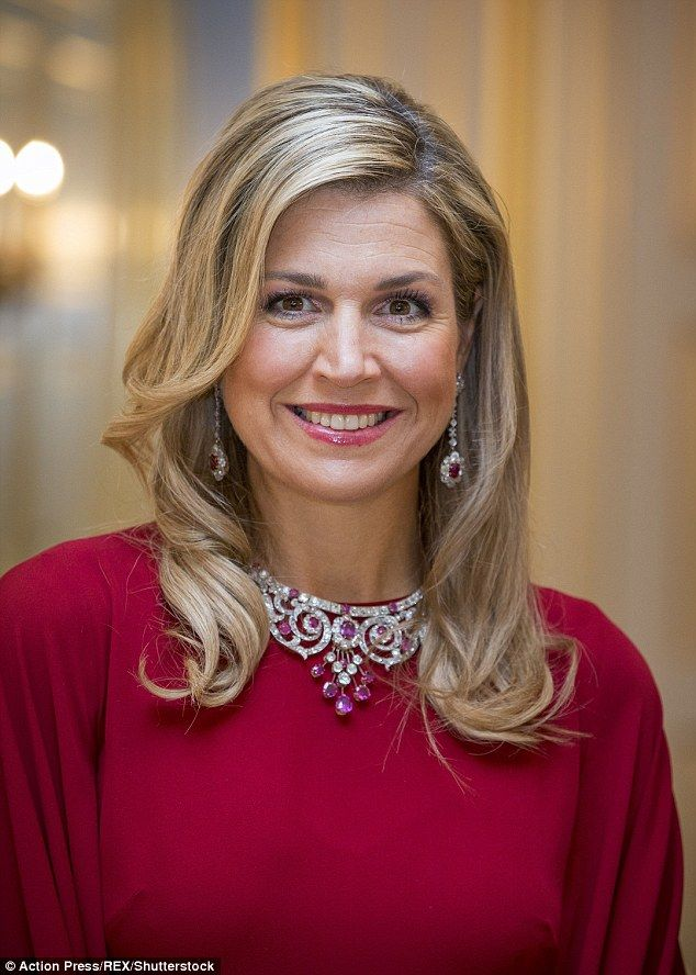 Fit for a queen: Mother-of-three Maxima added a touch of glamour to her Valentino gown wit...