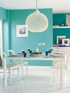 tourquoise walls n white furniture in kitchen