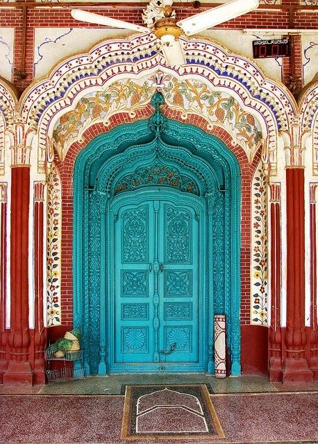 intricately carved blue doors, mohsinabad, pakistan
