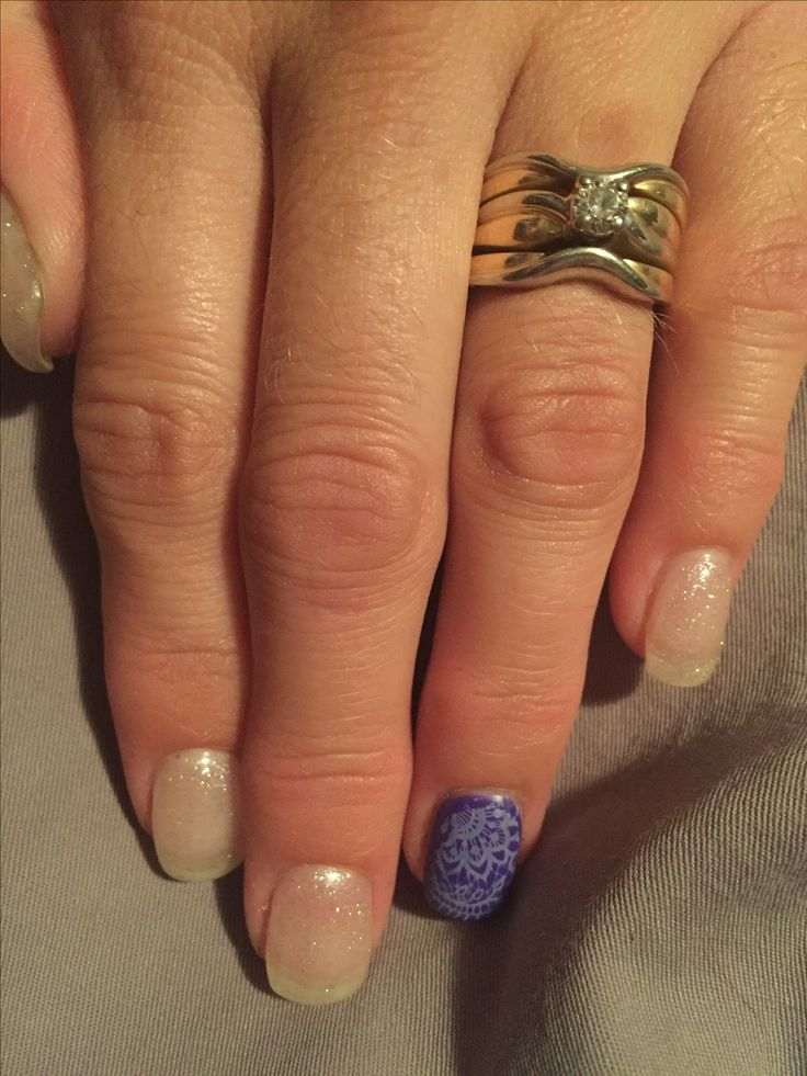 Elegant White glitter nails with Purple Lace!! Done by Melissa at Essential Balance in Quesnel, BC