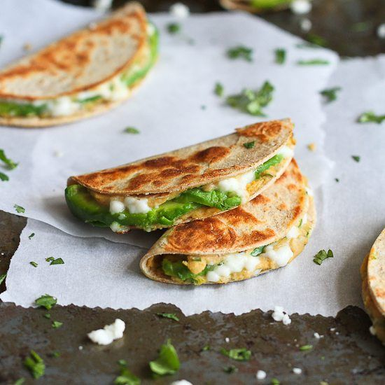 This mini quesadilla recipe will make snack time fun (and healthy!)  Stuffed with hummus and avocado, they're a breeze to make!