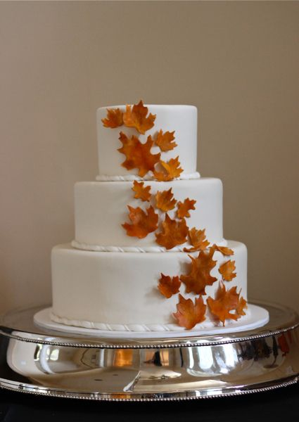 so simple and beautiful. I want this cake for my wedding. maybe add a small pumpkin at the bottom