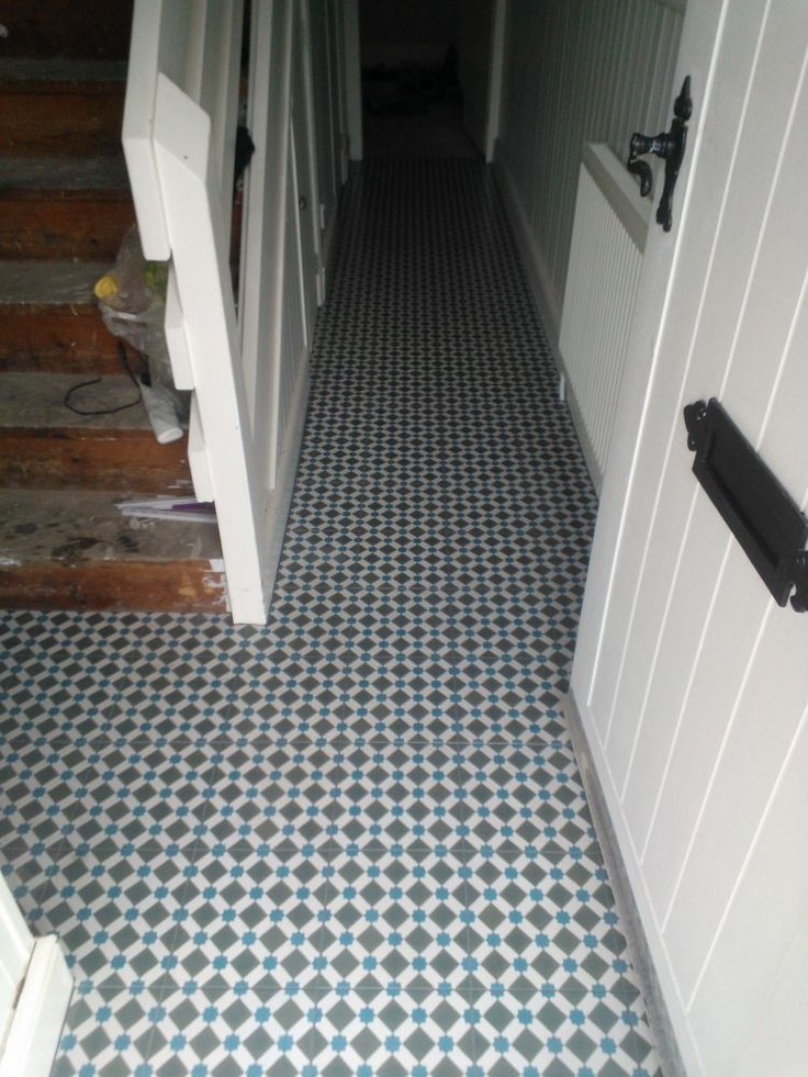 Looking good with the darker grout so the individual tiles stand out less. Topps Tiles