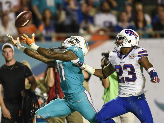 Miami Dolphins wide receiver Mike Wallace (11) cannot make the touchdown catch as Buffalo Bills free safety Aaron Williams (23) defends in the first half of the game