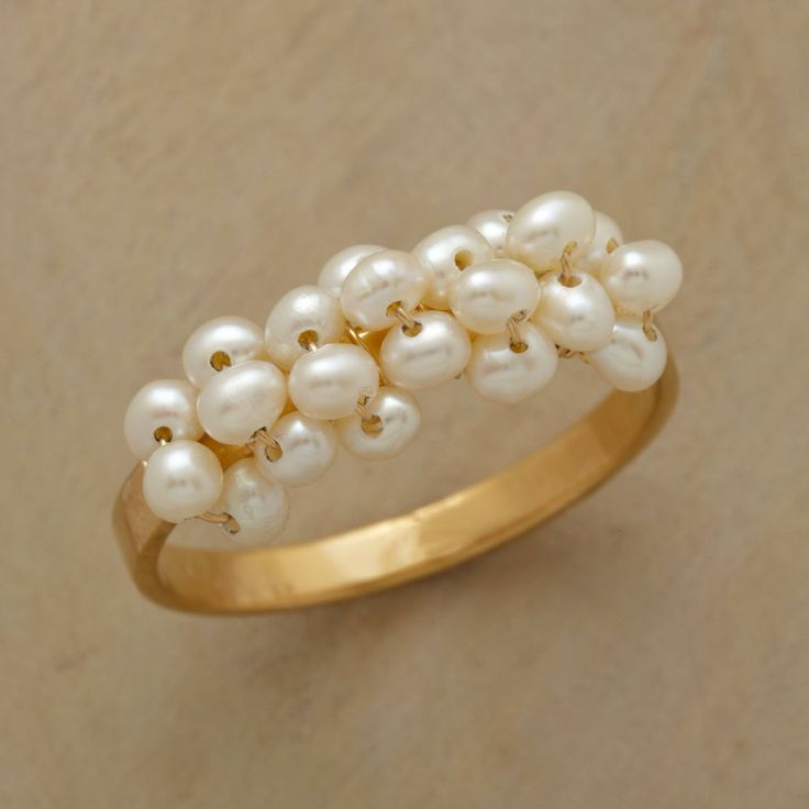 TINY BUBBLES RING -- A tiny bubbles pearl ring that features an airy arc of cultured freshwater pearls, evocative of such delights as champagne fizz and childhood fun. 14kt vermeil band. Handcrafted in USA. Whole sizes 5 to 9.