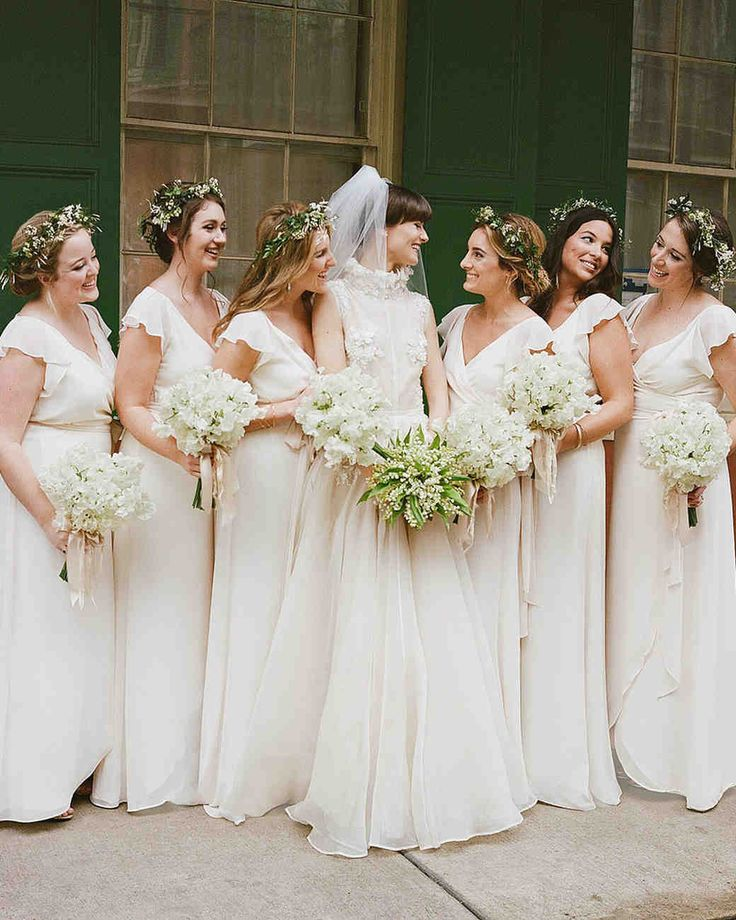 An Epic New Orleans Wedding with Classic Touches | Martha Stewart Weddings - Haylie (in Inbal Dror) shared a happy moment with her bridesmaids (including Bradley's sister, second from left), who wore dresses by Joanna August and wax flower and astrantia crowns made by Kim Starr Wise.