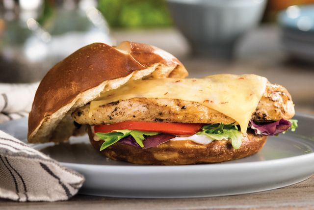 Mango chutney and habanero-studded cheese give these grilled chicken sandwiches their sweet and spicy appeal.