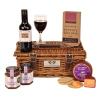 The perfect little hamper for the cheese and wine lover, a bottle of red wine and a claret infused cheddar truckle http://www.scottishhampers.co.uk/hamper/cheese-wine-12.html