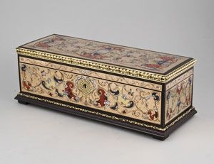 An antique glove box.  Wooden box applied with finely worked boulle work pannels and ormulu borders. The interior lined with red velvet.  The box and panels excellent condition.  Dimensions, base 28 by 11 cm, height 10cm