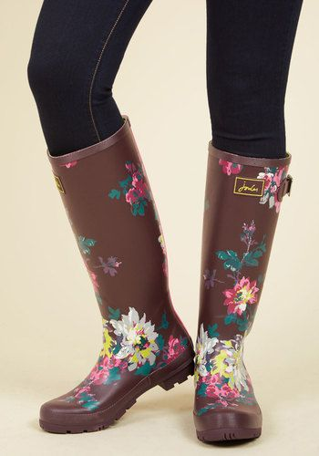 En route to your destination with plenty of time to spare? Luckily you're clad in these dark purple rain boots by Joules, for the child in your heart wants to splash! Touting gold buckles, treaded soles, and a watercolor floral print, these waterproof rubber boots make greeting puddles a giddy endeavor.