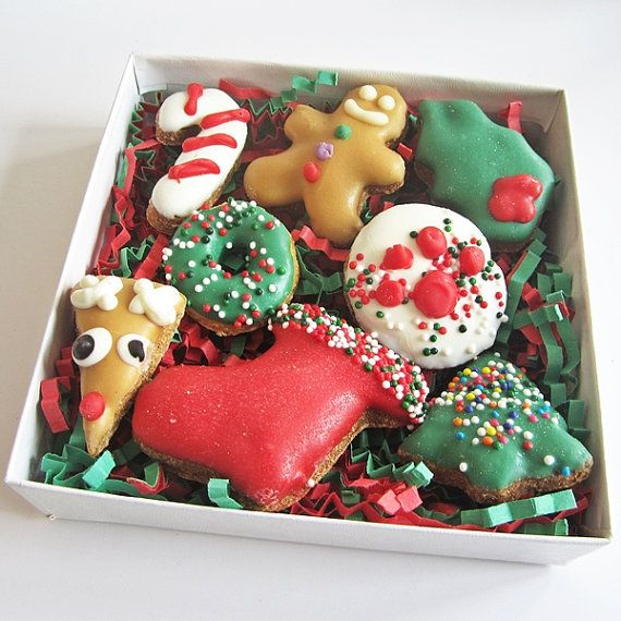 These cute bite size mini Christmas treats are made with a crunchy peanut butter dough, covered with peanut butter, yogurt or carob frosting. Our selection of 8 mini bites has a variety of shapes including gingerbread men, reindeer, candy canes, stockings, Christmas trees and more. The treats are placed in a clear gift box and tied with a bow.  Individual Dimensions: approx 1 x 1 inch Box Dimensions: 4 x 4 Flavor: Peanut butter dough Coating: Peanut Butter, yogurt and carob. Ingredients…