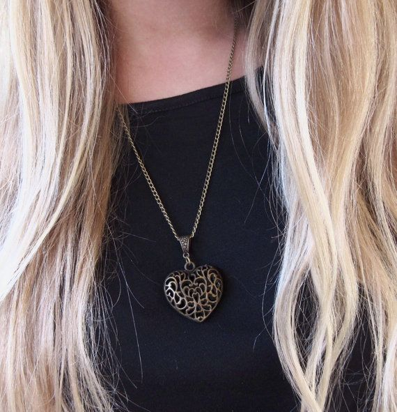 This is a beautifully engraved vintage heart pendant!  Trending these days it can be worn with jeans or that little black dress!  I have