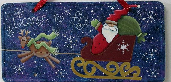 Licence to Fly, Santa,Sleigh and Reindeer, Licence Plate Sign,Christmas Sign,Up-cycled Metal Licence Plate,Tole or Hand Painted,Hanging Sign  Isnt this a FUN sign!! This is based on a Nancy Halverson quilting design. This fun sign features Santa in his Sleigh and a pulling reindeer!