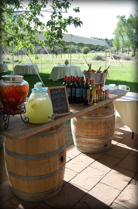 rustic outdoor wedding food bar with wine barrels / http://www.himisspuff.com/rustic-country-wine-barrel-wedding-ideas/3/