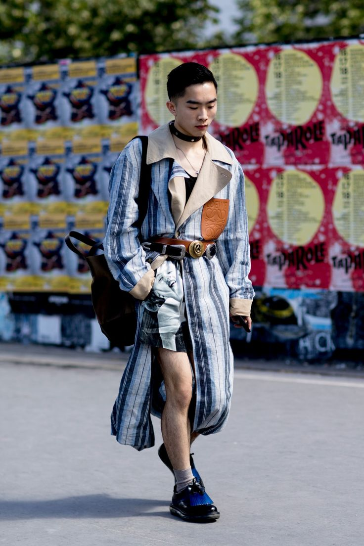 PARIS MEN'S FASHION WEEK STREET STYLE SPRING 2018 | DAY 5 | Writer, photographer and founder of The Bold Concept Jocelyn Yih wears Loewe Spring Summer 2017 coat, Loewe Autumn Winter 2017 belt, Topman belt, Dries Van Noten shorts, Baan Bag, Louis Vuitton choker, Balmain top and Prada shoes | Photo by Vincenzo Grillo of Imaxtree for The Impression (theimperession.com)