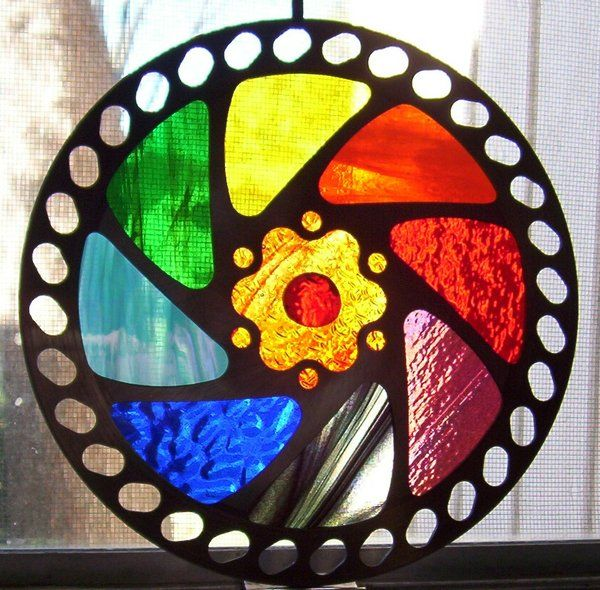 Bicycle gear with stained glass fitted into it by CindyCrowell