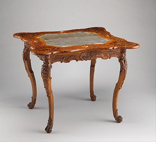 Card table Date: ca. 1745–50 Culture: German, Bamberg Medium: Carved walnut frame; pine top with marquetry of walnut, figured walnut, boxwood, alder burl, birch, olive wood, plum, padauk wood, yew, green-stained poplar, and other marquetry woods; lined with modern velvet; iron fittings