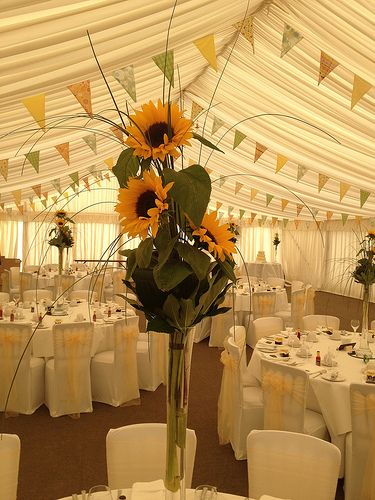 This was the sort of thing we were looking sat when we were considering tall centrepieces