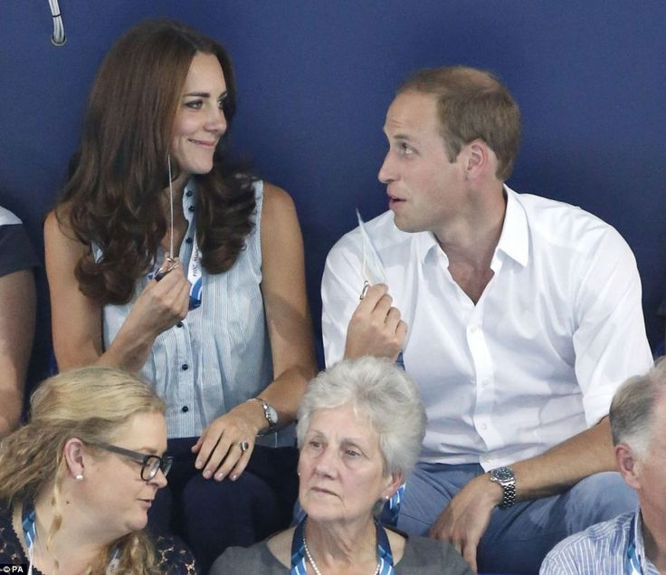 Prince William, aided by an official, fanned Kate using her identity card as they watched Jazz Carlin with the 800m freestyle gold medal at ...