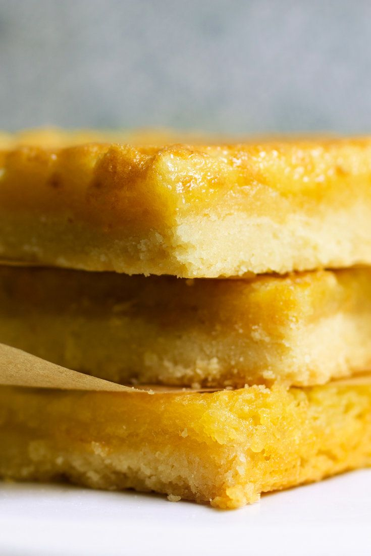 These heavenly little bars, adapted from the Southern cookbook author Julia Reed, are a modern-day, perfect-for-a-picnic version of a traditional custard pie made from flour, cornmeal, sugar, eggs, butter and buttermilk. They are like lemon bars without the lip-puckering citrus: a blanket of egg-rich custard generously laced with vanilla atop a lightly salted, crumbly shortbread crust. (Photo: Lisa Nicklin for The New York Times)