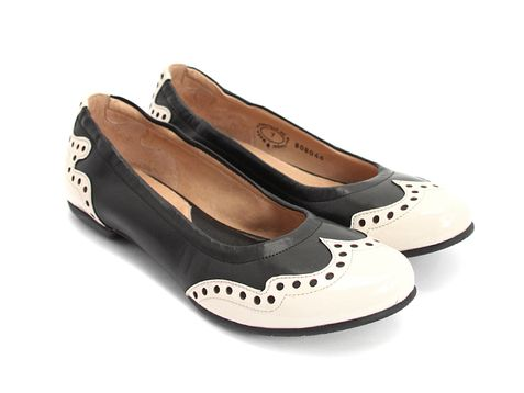 "Saddle shoes meet flats! This classic design -which is coming back into fashion- meets the flat which is the new ""it"" style too, and from a company making some serious comfort: Arabella (Black & Cream)"