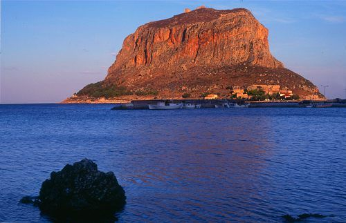 "Monemvasia, Greece--a medieval town on an island, invisible from the mainland, accessible only via one thin bridge (name means ""one entrance"")"