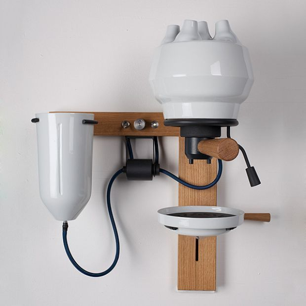 We love coffee and knowledge. Wall-mounted porcelain and wood coffee machine that shows you how it's done. Coffee lovers meet knowledge, knowledge meet coffee lovers.
